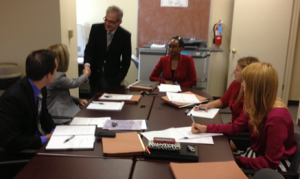 Shelby County Asst. Public Defenders Bill Robilio (standing) and Phyllis Aluko (center) meet with new law interns.