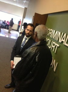 Shelby County Public Defender intern, Bryant Kroll, speaks with his client.
