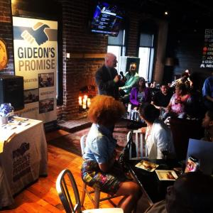 'Gideon's Promise' founder Jon Rapping speaking at a Memphis social about his organization's efforts.